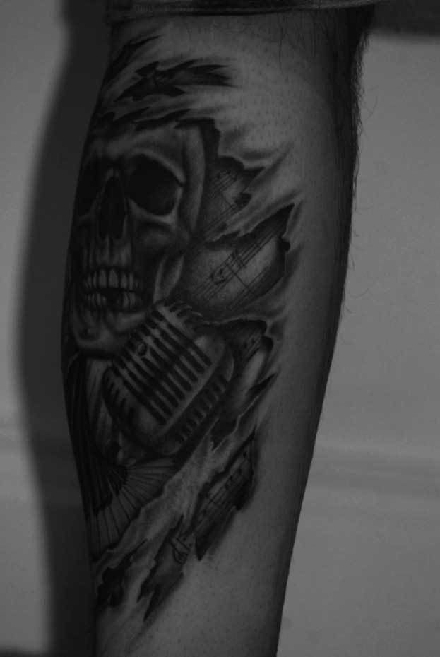 Skull-microphone-torn-skin-rosemary-mckevitt-tattoo-ireland