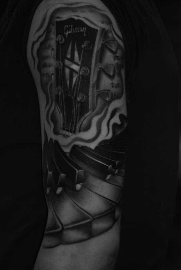 Gibson-guitar-piano-keys-music-rosemary-mckevitt-tattoo-ireland