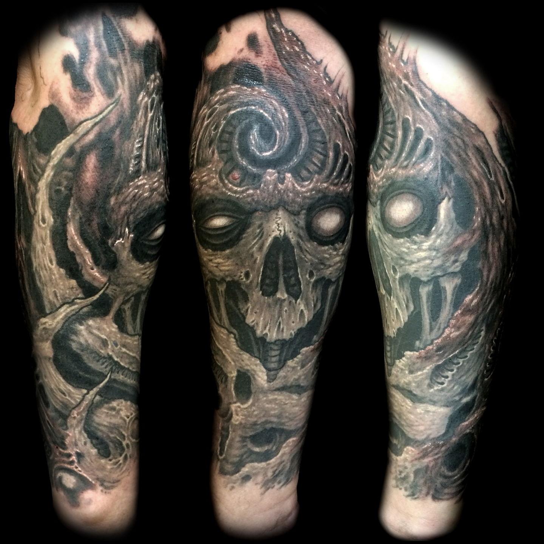 Las-vegas-tattoo-artist_joe-riley_biomech-skull-forearm-tattoos