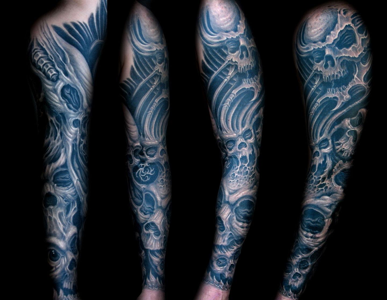 Las-vegas-tattoo-artist_joe-riley_biomech-skull-sleeve-tattoos