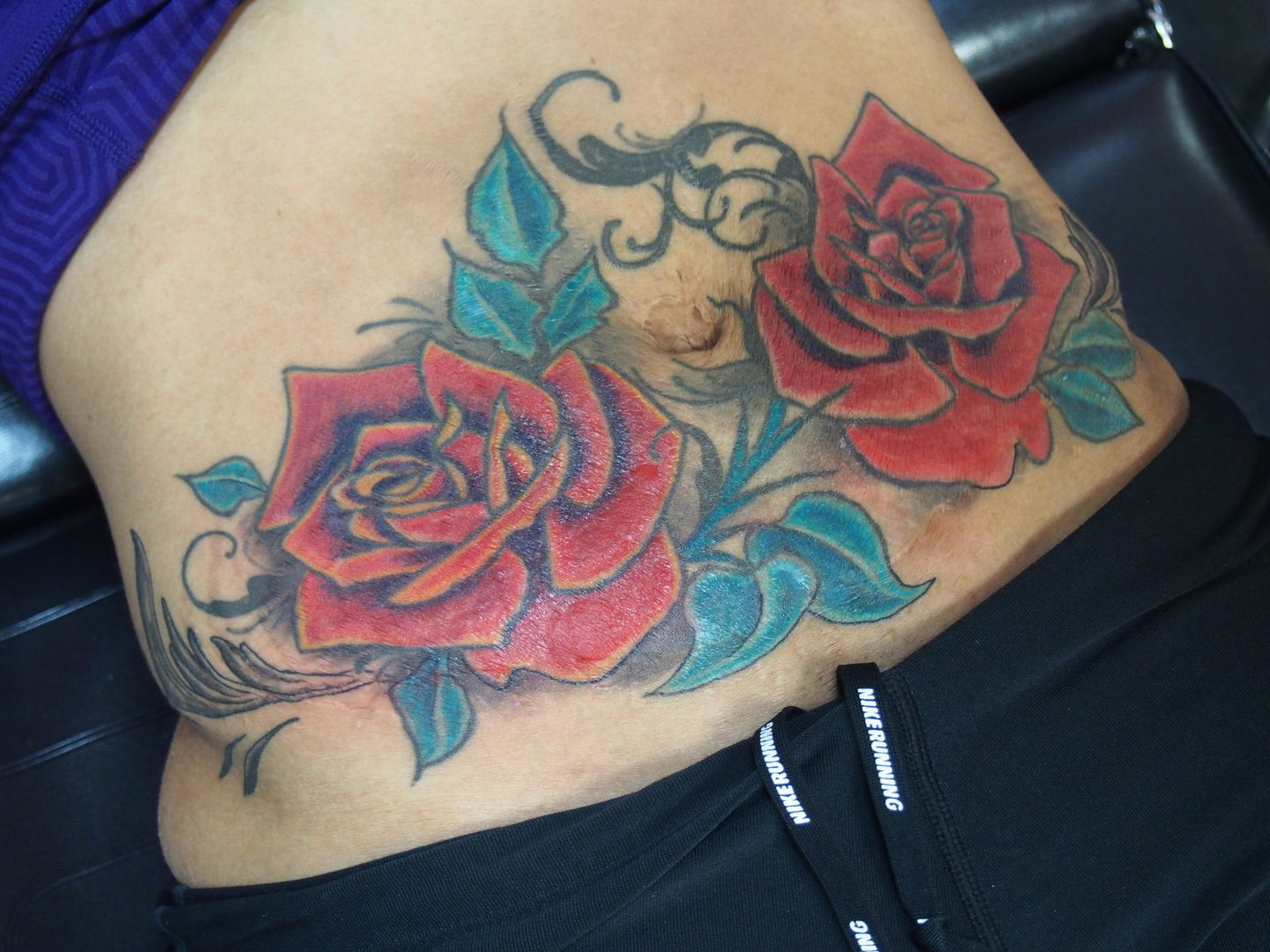 spirit:she-used-this-tattoo-to-cover-her-stretch-marks-color-roses ...